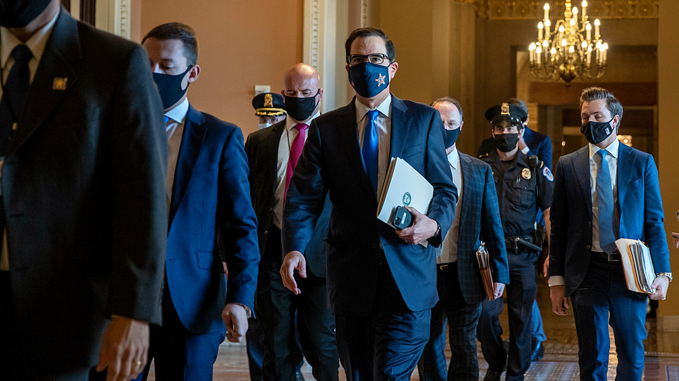 Secretary Munichin and others walking in Capitol halls with masks on