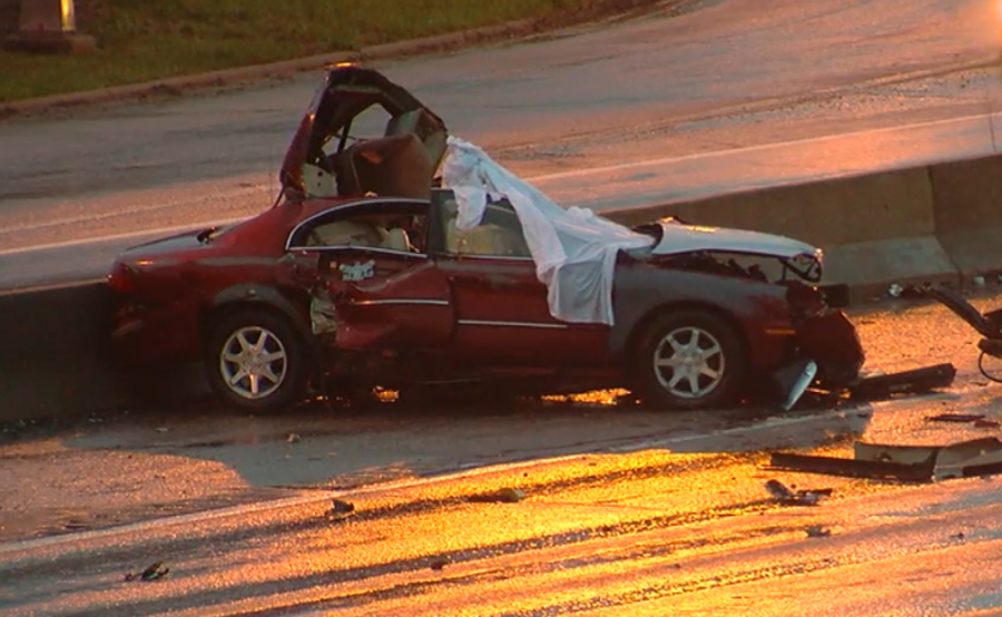 Woman dies after car crashes into semi, catches fire on